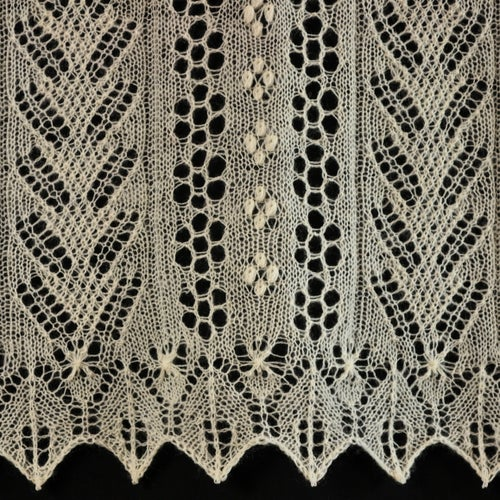Knitted lace from the Grain Field Stole Pattern.